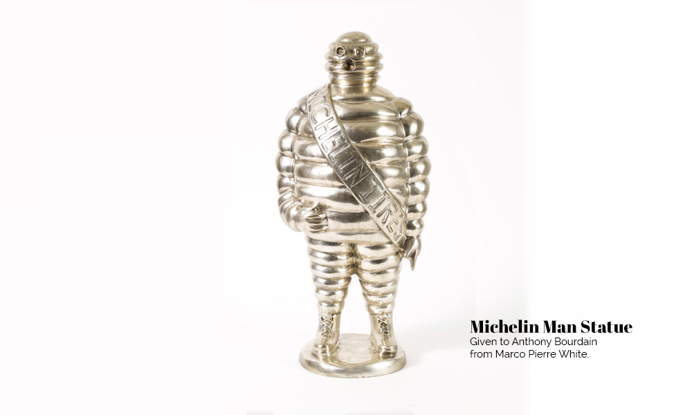 Anthony Bourdain Auction Michelin statue